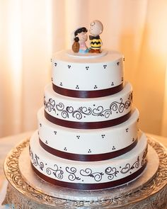 The Coyotes had a four tier vanilla buttercream cake with alternating tiers of vanilla cake with raspberry creme filling and marble cake with cannoli filling by Villa Italia Bakery. Photo by Upstate Photographers.