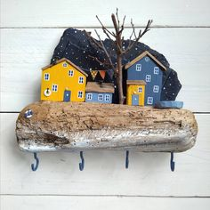 Image may contain: outdoor Painted Driftwood, Driftwood Crafts, Small Wooden House, Wooden Key Holder, Ceramic Houses, Wood Stone, New Years Decorations, Diy Holz, Miniature Crafts