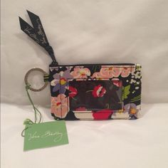 Vera Bradley Coin Purse New With Tag Vera Bradley Coin Purse in Poppy Fields design.  Very Pretty Print in one of Vera's retired designs.  Zip closure with an attached ring for keys.  See-through pocket on front for driver's license or photo.  Your new coin purse will be packed in pretty tissue and immediately shipped.  Happy Poshing! Vera Bradley Bags Wallets