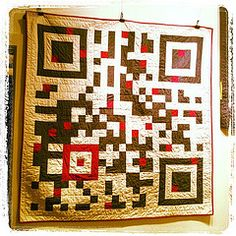 Keep warm this holiday season with a QR Code quilt.