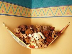 I have so much fabric that I can use for this. Just add loops on three corners of a sewed triangle, and connect to the wall on hooks or nails. A simple way to keep her 500 stuffed animals off the floor! And an easy way for her to clean....fast....