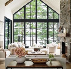 ღღ Simply gorgeous. Overlooking the water... Love the black windows how it frames the view, cozy room