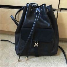 Zara drawstring backpack Drawstring backpack. Very stylish and in perfect condition. Used only 1x. Gold hardware on bag. Perfect size for an everyday bag! Comes with orginal dust bag. Unfortunately the dust bag has a small tear. But still protects! Bag retails for 50 Zara Bags Backpacks