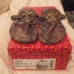 Tory Burch flip flop. Miller 2- snake print Size 6.5. Gold, metal emblem. Worn a handful of times. Comes with box. Tory Burch Shoes Sandals