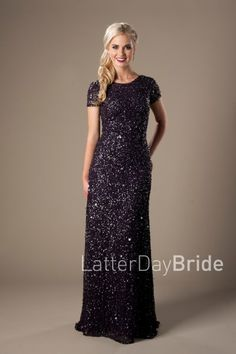 "Modest Prom Dress 2017 | LatterDayBride & Prom | SLC | Utah | Worldwide Shipping | Brinley | This stunning mermaid prom dress features illusion cap sleeves, a deep back neckline and is completely covered in sparkly sequins.    Back neckline is 7"" from the nape of the neck.    *Shown in Black."