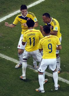 FIFA World Cup 2014 - Colombia 2 Uruguay 0 (6.28.2014) - El Nuevo Herald Colombia's James Rodriguez, left, dances as he celebrates with his teammates after scoring his side's second goal during the World Cup round of 16 soccer match between Colombia and Uruguay at the Maracana Stadium in Rio de Janeiro, Brazil, Saturday, June 28, 2014. Fabrizio Bensch / AP