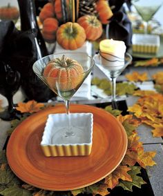 more ideas for table settings.. place a dessert in a martini glass. wrap your candles with black decor wire. use black chargers, colorful plates and silk leaves. make your centerpiece with branches and pine cones. CP Ross Designs