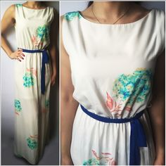"""White Floral Maxi Dress MADE IN USA - This stunning white floral maxi dress is so stunningly beautiful and perfect for Spring! Features a self tie royal blue sash, keyhole opening in back with button closure, side slit and lined attached slip. 100% poly so won't shrink! Apprx 57"""" long. Price is firm unless bundled as these were expensive. S(2-4) M(6-8) L(10-12) you may purchase this listing if it's your size as I've created individual listings for each size. Get them quick before they go…"""
