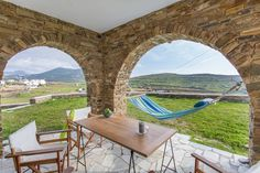 House in Tinos, Greece. Villa Vissilos is our welcoming fresh Cycladic home with a positive aura. Stylish & functional, it is a serene summer getaway. Located just 4km from town and close to 3 beautiful beaches, it is the ideal place to relax in & explore magnificent Tin...