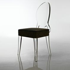 Thinking of getting ghost chairs with white upholstery to go with my Z Gallerie table