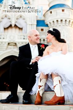 This bride shows some personality in cowgirl boots in front of Cinderella's Castle