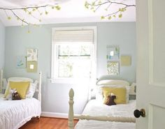 Gray blue walls, white on white beds, lime green accent.  Lovely.