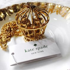 "Kate Spade Gold Pair of Birds Caged Necklace Brand new Kate Spade ""Caged Birdcage"" necklace with tags. Comes with the dust bag. This necklace is 12 karat plated gold with a lobster claw closure and is 32"" in length. Please ask if you have any questions. I adore this necklace but it's just a little longer than I hoped for my 5'4"" frame. Bundle and Save Open to offers through the offer button. kate spade Jewelry Necklaces"