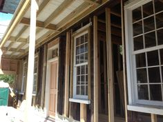 Old siding stripped off with some used for repair on the north side. Windows and doors back in ready for new boarding.  #charleston #historic #home #renovation