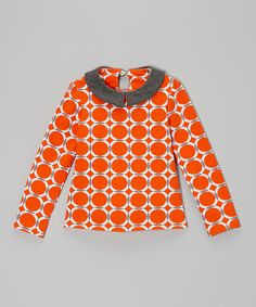 Mixing a simple silhouette with a hip geometric print, this collar top is both classic and thoroughly modern. An eyelet closure in the back lets it slip right on, making it oh-so easy to create a spunky and stylish look.95% cotton / 5% LycraMachine wash; tumble dryMade in the USA