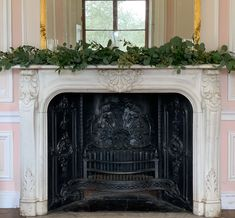 A lush mixed foliage mantle garland created using eucalyptus, soft Italian ruscus and pittosporum