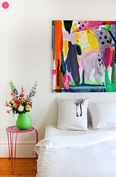 The art-as-headboard isn't terribly exciting, but I love the bedside stand and the colorful flowers in the green vase. Wouldn't it be fun to have a huge house where you could do a different color scheme for every room? I could scratch my green itch in small doses!