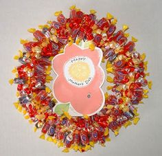 A candy wreath is one of these Mother's Day gifts. Candy Wreaths can also be easy and fun Mother's Day crafts for kids. They will enjoy working with candy and will be proud to make and give their mom a beautiful and tasty gift.