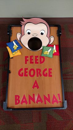 "Post Curious George Party Game - ""Feed George a Banana"" - just deck out your cornhole game!Curious George Party Game - ""Feed George a Banana"" - just deck out your cornhole game! Curious George Party, Curious George Crafts, Curious George Games, Curious George Birthday, Tween Party Games, Graduation Party Games, Birthday Party Games, First Birthday Parties, First Birthdays"