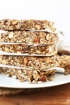 Simple vegan, gluten-free granola bars loaded with 4 kinds of seeds: hemp, flax, sunflower, and chia! Super healthy and perfect for a healthy snack on the go.