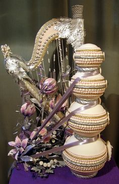 Musical Cake with four tiers of round beaded cake, harp and flowers