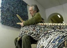 """Italian artist Ivano Vitali uses giant knitting needles for his work with paper in the """"Crossovers: Materials and Metaphors"""" exhibit Art Au Crochet, Knit Art, Learn To Crochet, Knit Crochet, Crochet Hooks, Recycle Newspaper, Newspaper Art, Knitting Projects, Knitting Patterns"""