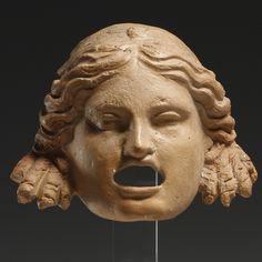 Lot No.261 - A NEW COMEDY THEATRE MASK ,terracotta,greek,culture,3rd cent.BC