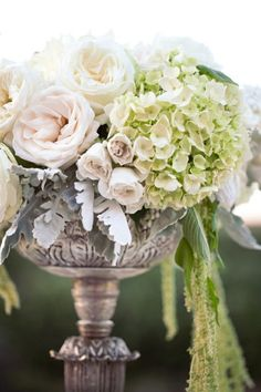 Elegant centerpiece with dusty miller, hydrangea and garden roses