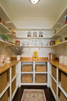 Let wood do the talking. Beadboard paneling (added to Sheetrock) is painted a clean white here. Yes, it's still white, but its texture, along with the shelves' brackets, changes the entire look. Now the pantry is reminiscent of a farmhouse or country store.
