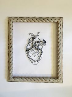 Wire sculpture : Human Heart. A wonderful gift for someone special in your life. It speaks of the fathomless depths of love of which the human heart is capable. Easy to hang. Wooden frame is not included in this item but available Measures 5 1/2 x 8 1/2 inches More artworks at: https://www.etsy.com/shop/morphingpot