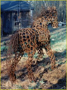 LooSee Art - Old Iron: He is a full size draft horse who stands almost 6' at the shoulder (withers, 17 hands). Comprised completely with donated, recycled horseshoes. His mane and tail are unraveled steel cable.