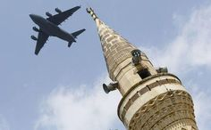 File photo of a U.S. Air Force Boeing C-17A Globemaster III large transport aircraft flies over a minaret after taking off from Incirlik air base in...