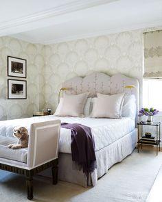 Caroline Cummings Rafferty's canine companion kicks his paws up in the master bedroom of her Manhattan home.   - ELLEDecor.com (=)