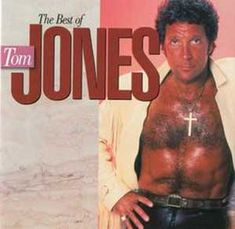 Tom Jones and definitely a tan from the past!  Yikes. Did he happen to die of skin cancer?!?  That's some tan.