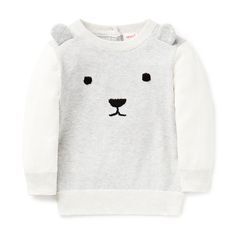 100% Cotton Sweater. Knitted sweater with contrast sleeves, 2x2 rib neck, hem and cuffs. Features embroidered bear face on front panel and applique ears. Regular fitting silhouette. Available in colour shown.