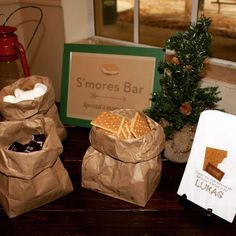S'mores bar at a camping birthday party! See more party planning ideas at CatchMyParty.com!