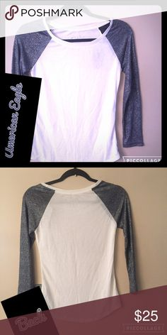 American Eagle White T w/Bling Sleeves American Eagle White T Shirt w/Silver Bling Sleeves. Sleeves come past elbows & T has rounded neckline. Runs big American Eagle Outfitters Tops Tees - Long Sleeve