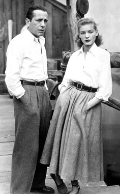 1940s: Humphrey Bogart and Lauren Bacall from Best Dressed Celeb Power Couples  Actors Humphrey Bogart and Lauren Bacall were constant costars on the big screen, and the IRL couple was naturally thrust into the spotlight as a result. Their fame coincided with the rise of the American sportswear trend, which was a welcome alternative to the more formal fashion before it. The couple often wound up sporting similar looks. For instance, take the duo, on the set of their movie Key Largo, both in…