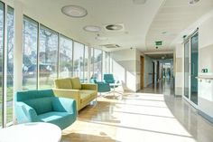 PHOTO TOUR: Sir Robert Ogden Macmillan Centre, Harrogate District Hospital | Healthcare Design --- The sub-wait area links the consultation and treatment units. This area, adjacent to a phlebotomy room, serves patients and their families and is bathed in natural light. Photo: Infinite 3D Architectural Photography