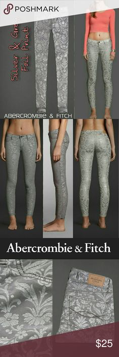 "A&F Grey Silver Foil Skinny Jeans / Jeggings - 4 (Selling for $50 on eBay!) Retail $98   Abercrombie & Fitch A&F Womens SEXY Mid Rise Jeggings  with Floral Foil Print  Size 4 (27)  Color: Grey Shine Pattern, a floral baroque style print.  Mid rise waist, pretty shimmering all-over floral pattern, iconic back pocket stitching, jegging fit. Cute cuffed!  99% Cotton, 1% Elastane.  Waist 28.5"" flat, stretch to 30"" max. Hips 35-36.5"" Front Rise 8.75"", Inseam 29.5"", Ankle Opening across 5.5"" with…"