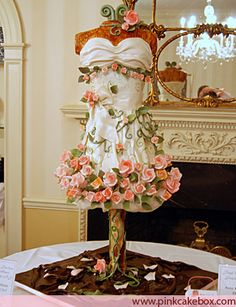 """Hand painted party dress cake with sugar roses, vines, and leaves. 46"""" tall; sour cream orange zest cake with pistachio filling and white chocolate buttercream."""
