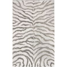 Want.  Have an affinity for zebra rugs!  Hand-tufted wool and art silk rug with a grey zebra-stripe motif.   Product: RugConstruction Material: Wool and...