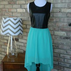 "3/$15 Free Bird Faux Leather Hi-Lo Dress Bundle 3 items marked ""3/$15"" in the title and make me an offer of $15! I will accept!  FINAL PRICE! Adorable and edgy faux leather dress by Free Bird in excellent worn condition. Free Bird Dresses"