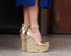 This SCENE style takes the hot cork-wedge trend to the next level of chic with its flattering silhouette and decorative buckle accent.