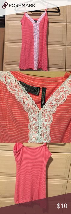 A pink and white stripped Cami A pink guess Cami w white strips and lace down the middle. Tight fitting. GUESS Tops Camisoles