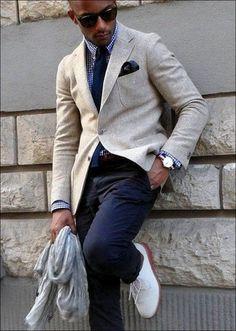Men's Dark Brown Sunglasses, Navy and White Gingham Dress Shirt, Navy Wool Tie, Black Pocket Square, Dark Brown Leather Belt, Navy Chinos, Grey Scarf, White Leather Derby Shoes, and Beige Wool Blazer