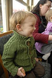 Old School Cardigan is a vintage-inspired, raglan cardigan, for a boy or a girl, with cable panels and a ribbed collar. Knit in a rugged cotton, it can withstand a toddler's daily wear-and-tear.