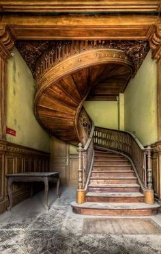 Beautiful staircase inside an abandoned house.