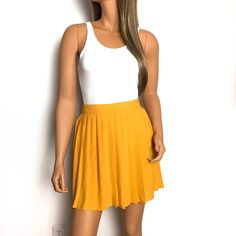 """Mustard color pleated skirt Vibrant and pretty orange-yellow mustard colored pleated skirt.  Has side hidden zipper and skirt lining and light flowy fabric.  I wore this twice at most. Cute skirt for going out.   Condition: gently used, a couple of light markings as shown that's barely visible, great condition overall.  Size: S Waist: 13 inches across Length: 16"""" Fabric: polyester  🚫trade 🛍bundle and save discount shown below Forever 21 Skirts Circle & Skater"""