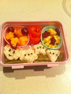 Rice shape caterpillar, cheese flowers and fruit with a tomato rose and green beans.